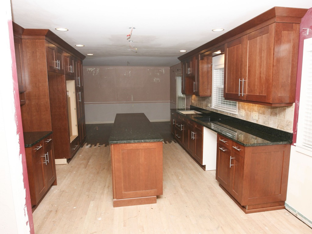 Expand kitchen into dining room to enlarge the room