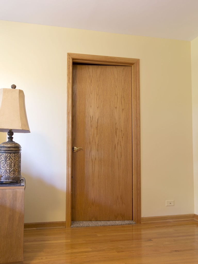 This outdated average door will be replaced with beautiful knotty alder door.
