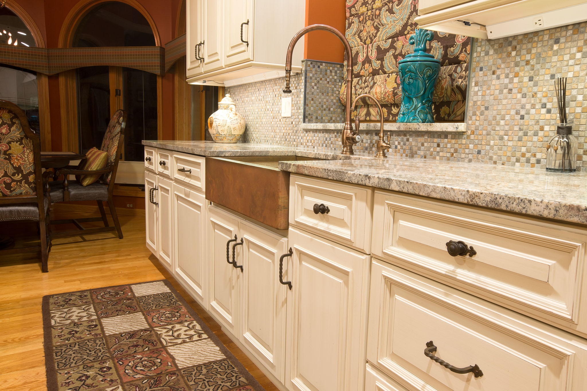 Off white kitchen cabinets with copper kitchen sink