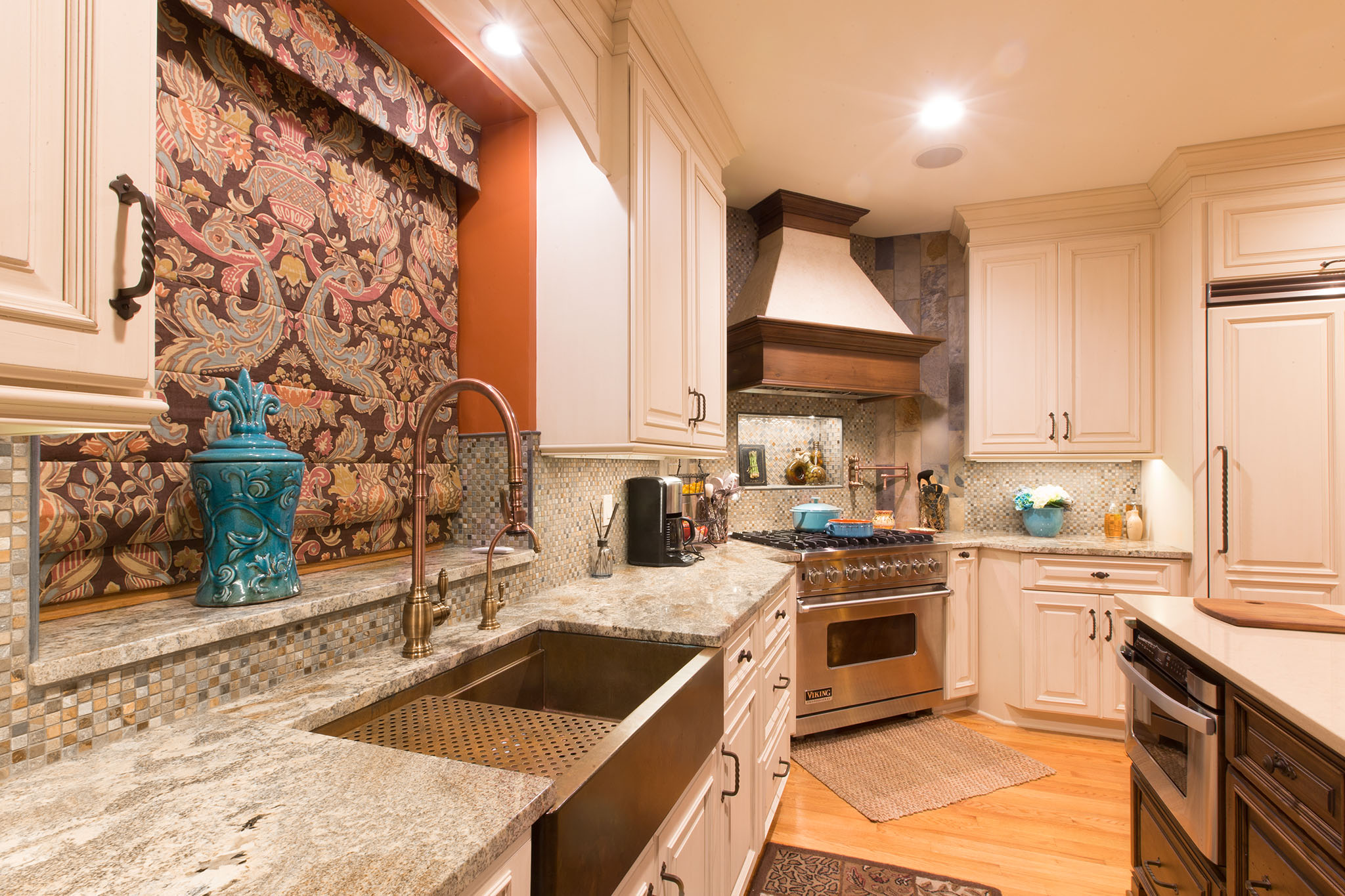 Multi color kitchen cabinets with matching kitchen hood